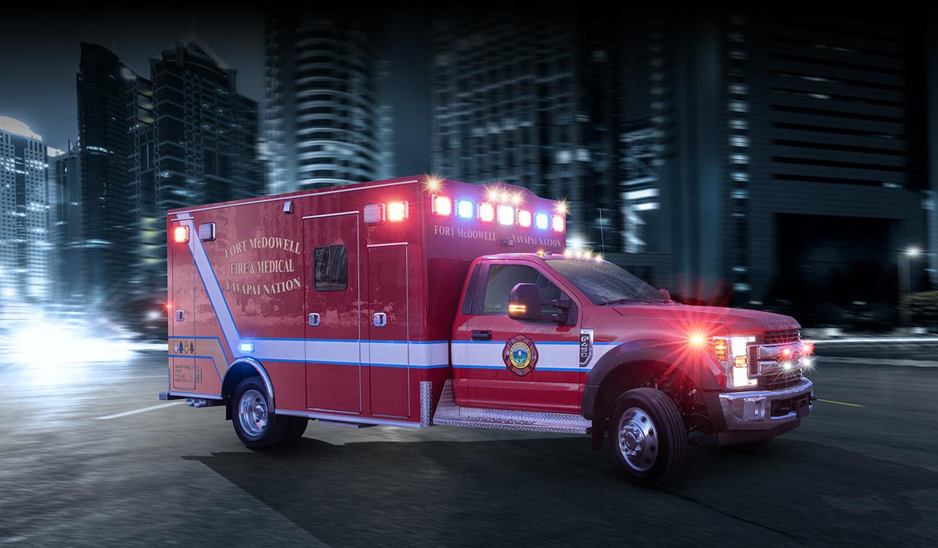 Medix MSV-II 170 Type I Ambulance on a street at night